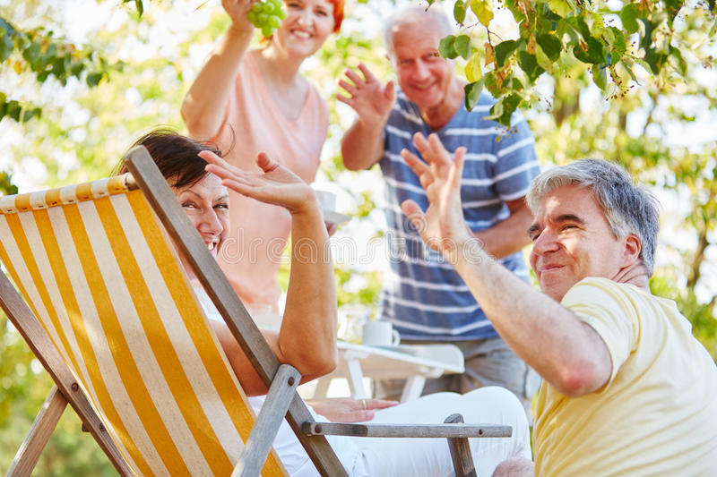 Group of senior friends having a party at the park royalty free stock photos