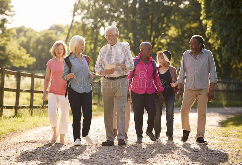 Group Of Senior Friends Hiking In Countryside stock photo