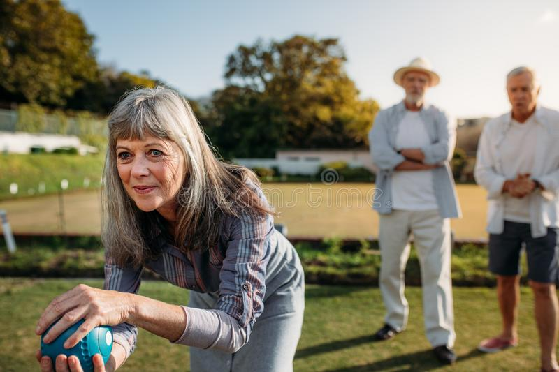 Group of senior friends playing boules royalty free stock photography
