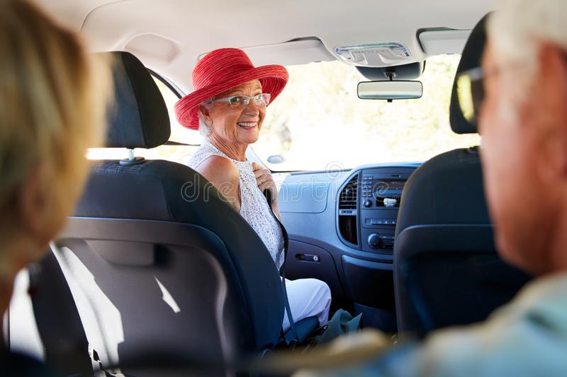 Group Of Senior Friends Sitting In Car Driving To Vacation stock photos