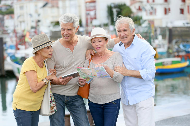 Group of senior friends on a trip enjoying royalty free stock photography