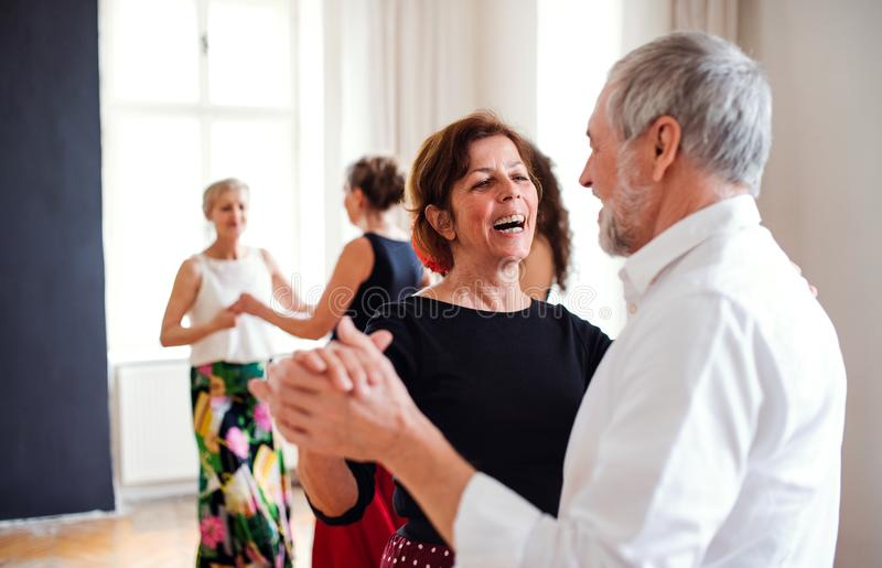 Group of senior people in dancing class with dance teacher. stock images