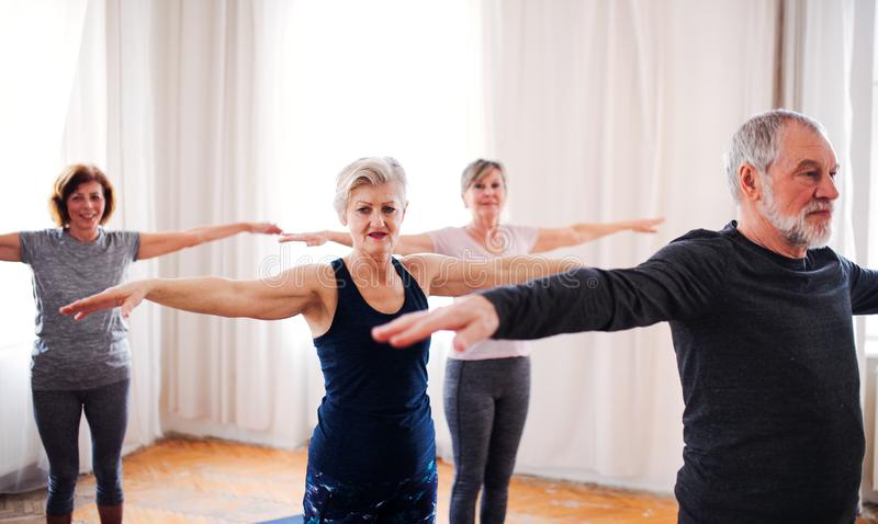 Group of senior people doing exercise in community center club. royalty free stock images