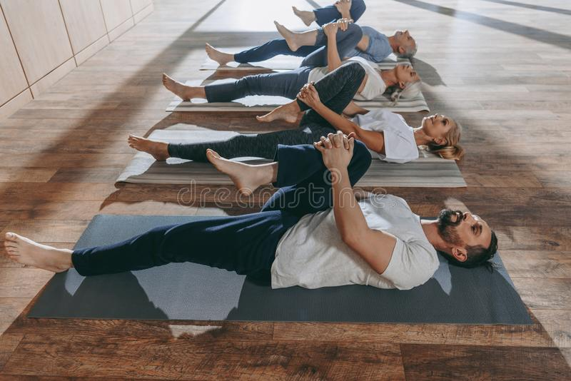 group of senior people stretching in yoga mats royalty free stock photo