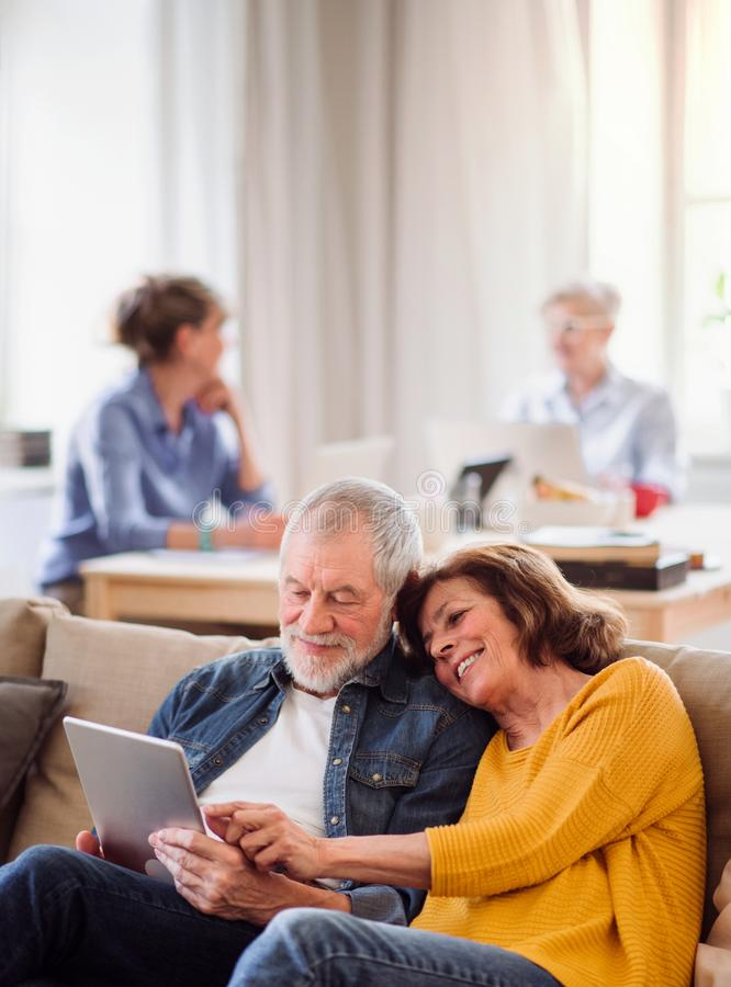 Group of senior people using laptops and tablets in community center club. stock photo