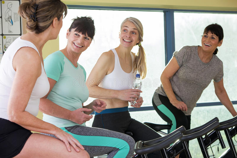 Group of senior women having a chat at the gym royalty free stock image