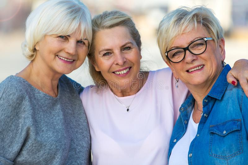 Group of senior women smiling royalty free stock photography