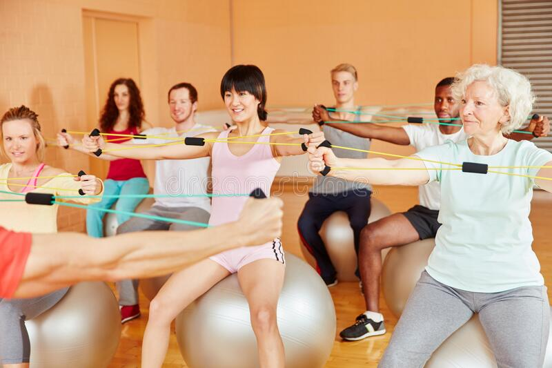 Group with senior woman on course in fitness center royalty free stock photos
