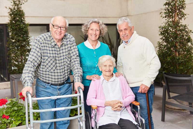 Group seniors as retirees in retirement home. Group of seniors as pensioners in a retirement home or a senior residence royalty free stock images