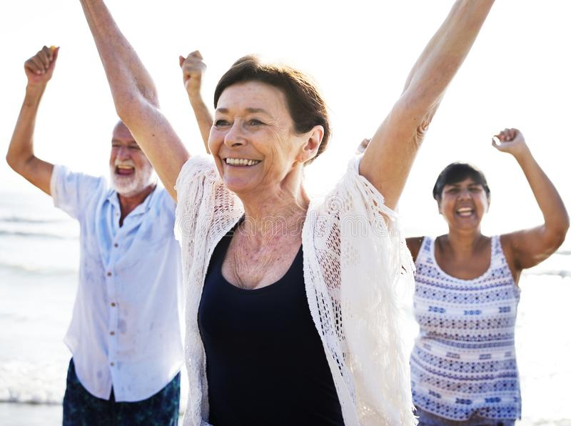 Group of seniors on the beach stock photography