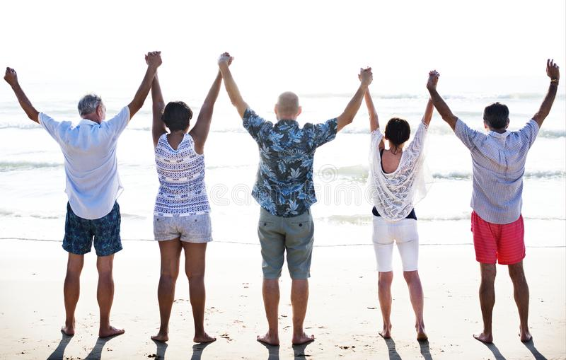 Group of seniors on the beach royalty free stock photography
