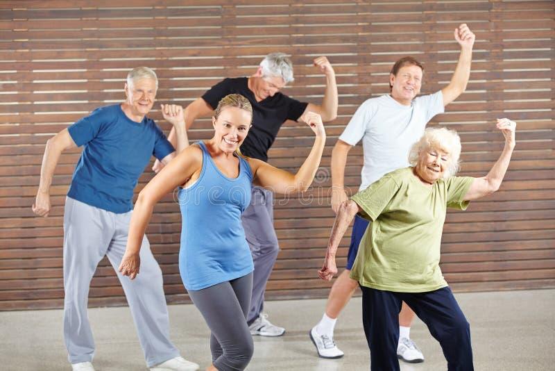 Group seniors dance Bokwa in the fitness center stock photo