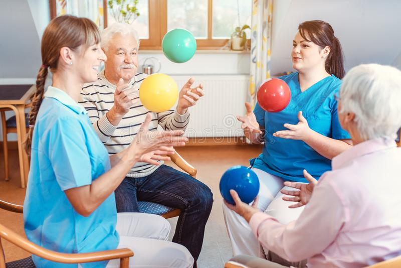Group of seniors doing sport and gymnastics with balls stock photo