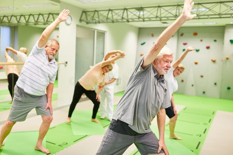 Group of seniors doing stretching exercise in rehab stock photo