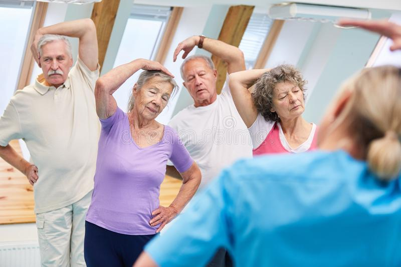 Group of seniors doing stretching exercise stock photos