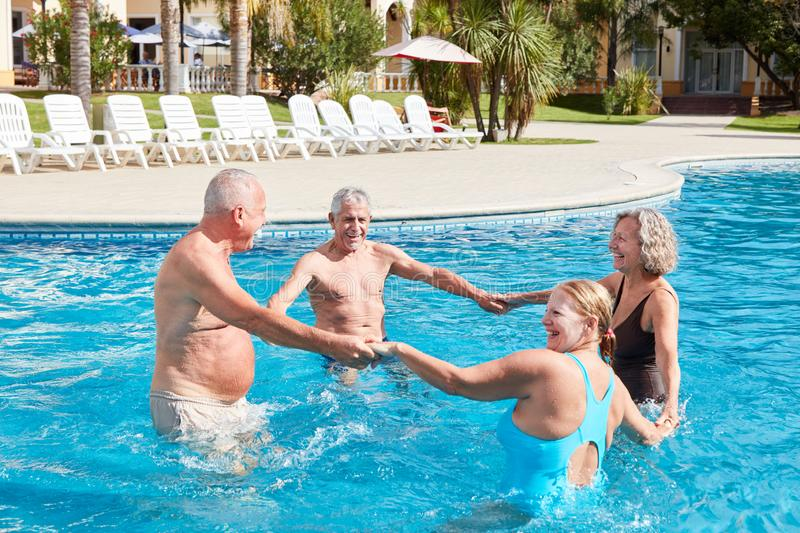 Group of seniors doing water aerobics royalty free stock images
