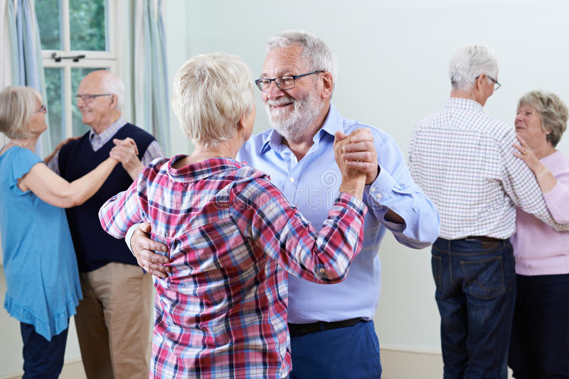 Group Of Seniors Enjoying Dancing Club Together stock photography