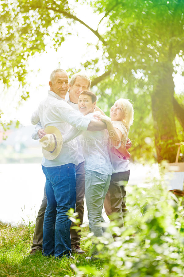 Group of seniors in garden of retirement home royalty free stock photo