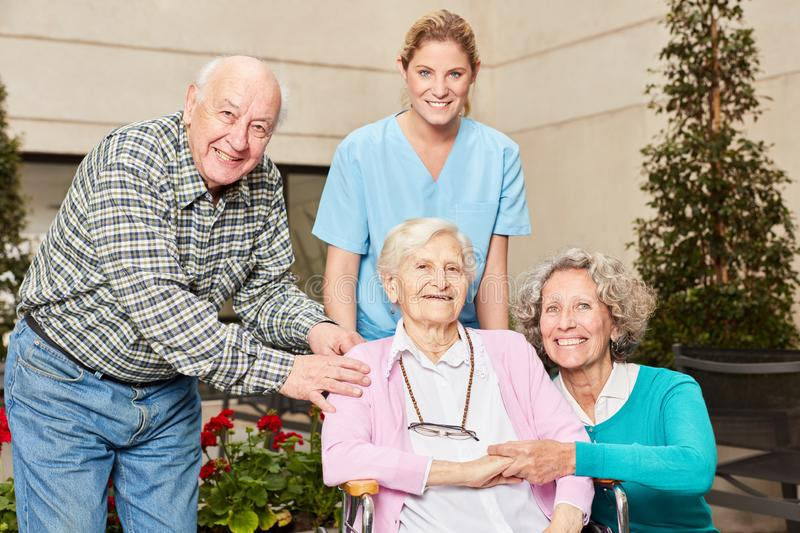 Group of seniors with geriatric nurse. In nursing home or nursing home royalty free stock image