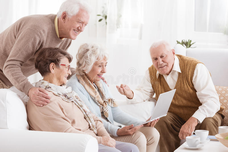 Group of seniors with laptop royalty free stock photography