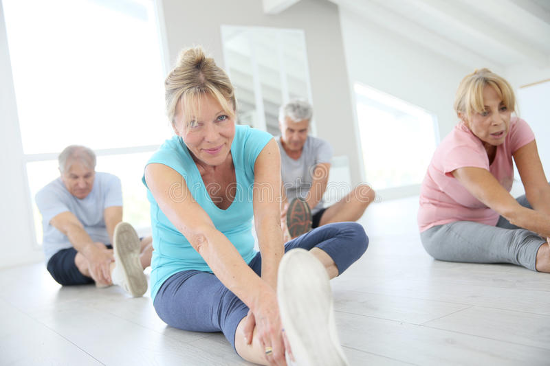 Group of seniors making stretching excercises. Group of senior people doing stretching exercises royalty free stock photography