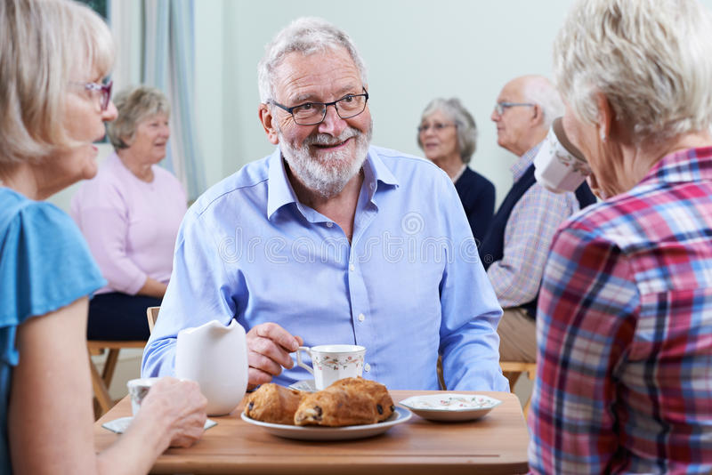 Group Of Seniors Meeting At Social Club. Group Of Seniors Meet At Social Club royalty free stock photography