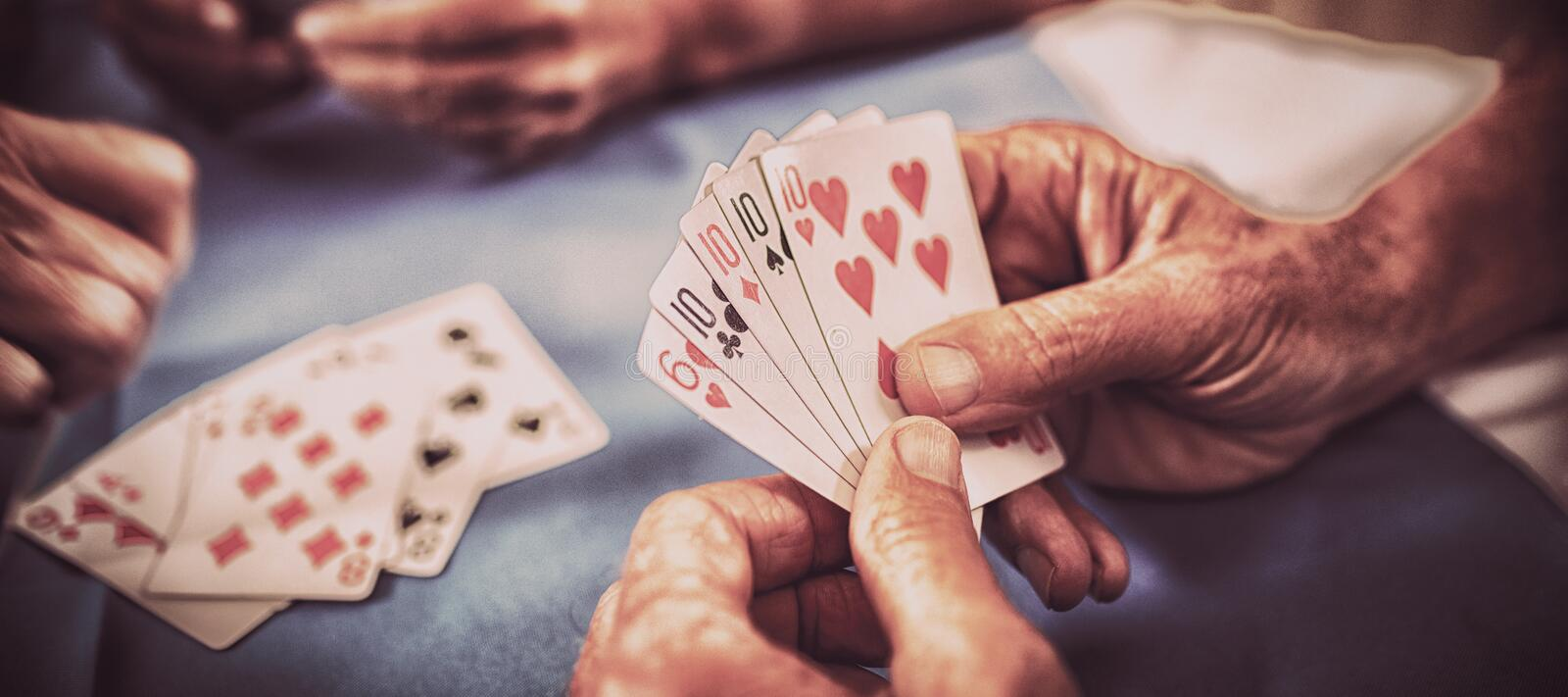 Group of seniors playing cards stock images