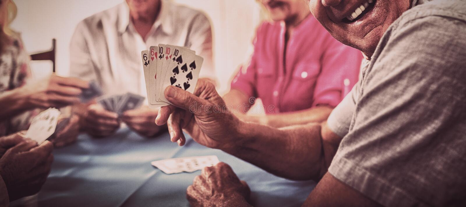 Group of seniors playing cards royalty free stock photo