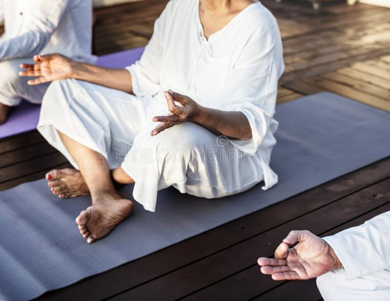 Group of seniors practicing yoga royalty free stock images