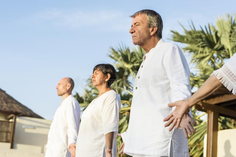 Group of seniors practicing yoga in the morning stock photos