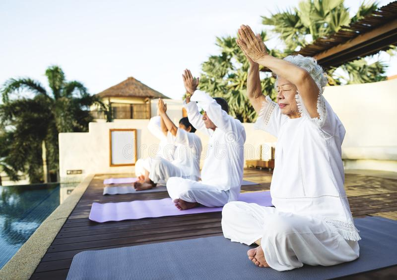 Group of seniors practicing yoga in the morning royalty free stock photos