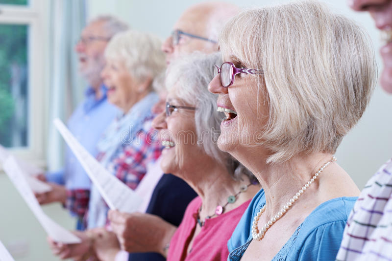 Group Of Seniors Singing In Choir Together. Group Of Seniors Singing In Choir royalty free stock photography