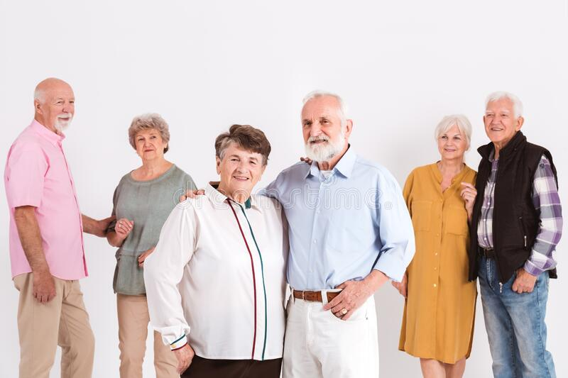 Group of seniors standing in room stock photos