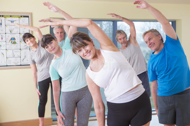 Group of seniors stretching stock images