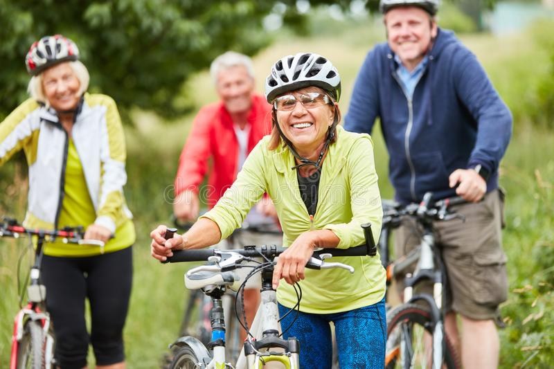 Group of seniors riding a bicycle. Group of seniors together while cycling in the nature on a bike tour royalty free stock photos