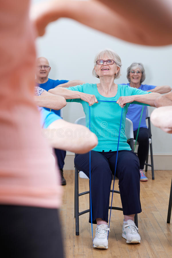 Group Of Seniors Using Resistance Bands In Fitness Class. Group Of Seniors Use Resistance Bands In Fitness Class royalty free stock photo