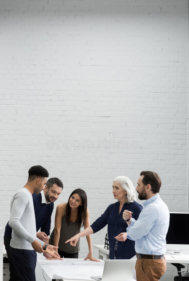 Group of serious business people having a brainstorm meeting royalty free stock images