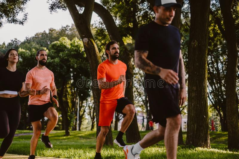 Group of serious people running in the park royalty free stock photos