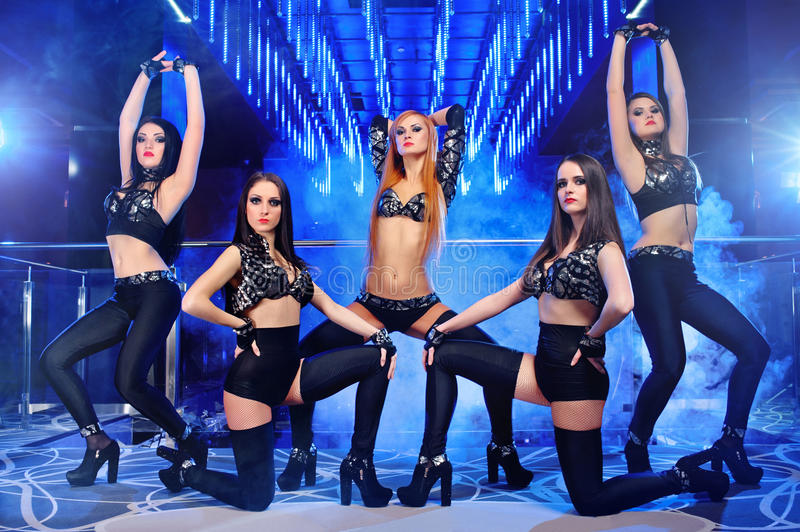 Group of go-go dancers wearing black outfits royalty free stock image
