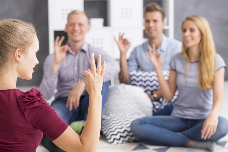 Group of sign language learners royalty free stock photo
