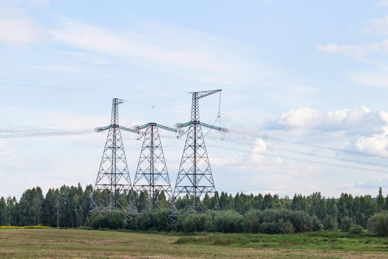 Group silhouette of transmission towers power tower, electricity pylon, steel lattice tower . Texture high voltage stock image