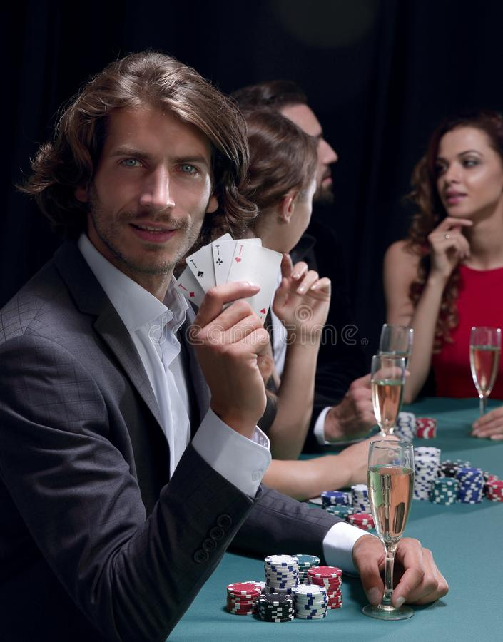 Group of sinister poker players stock image
