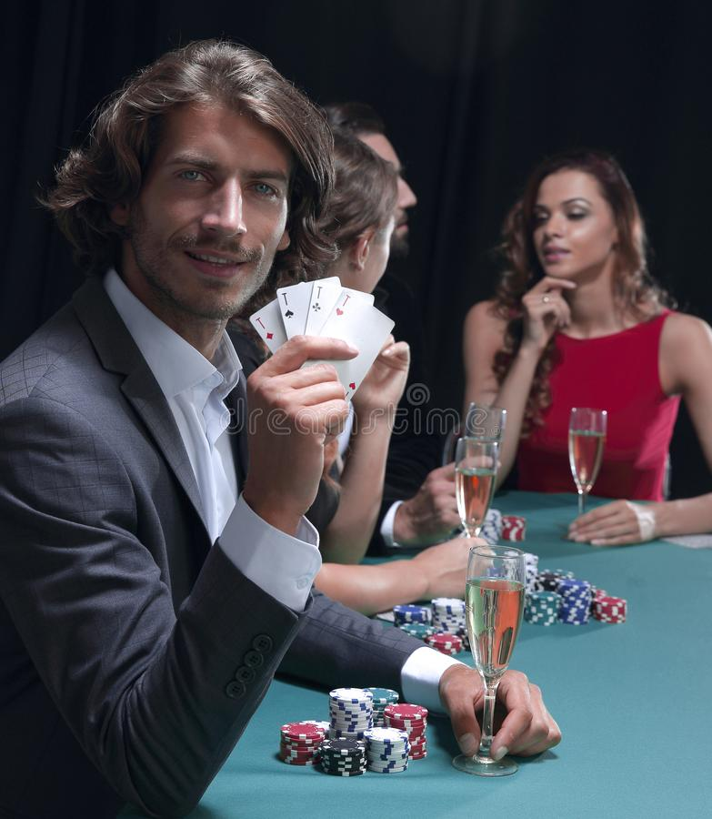 Group of sinister poker players stock photos
