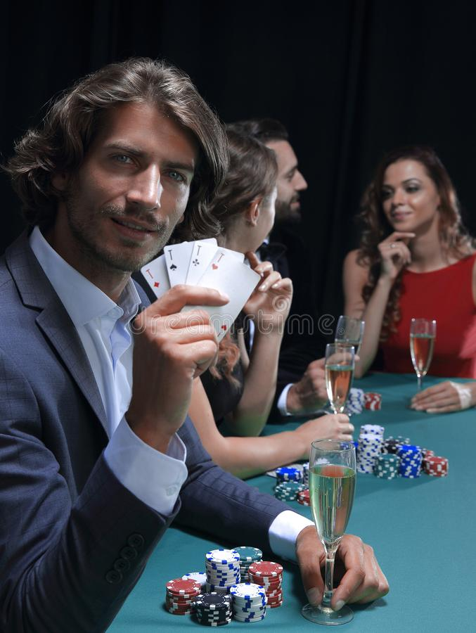 Group of sinister poker players royalty free stock photo