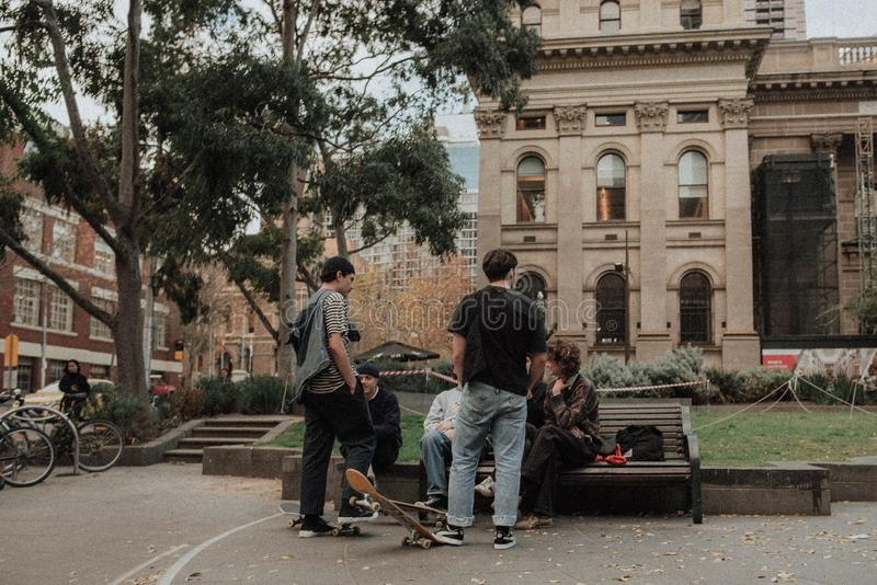 Group of skateboarders at a park discussing something royalty free stock image