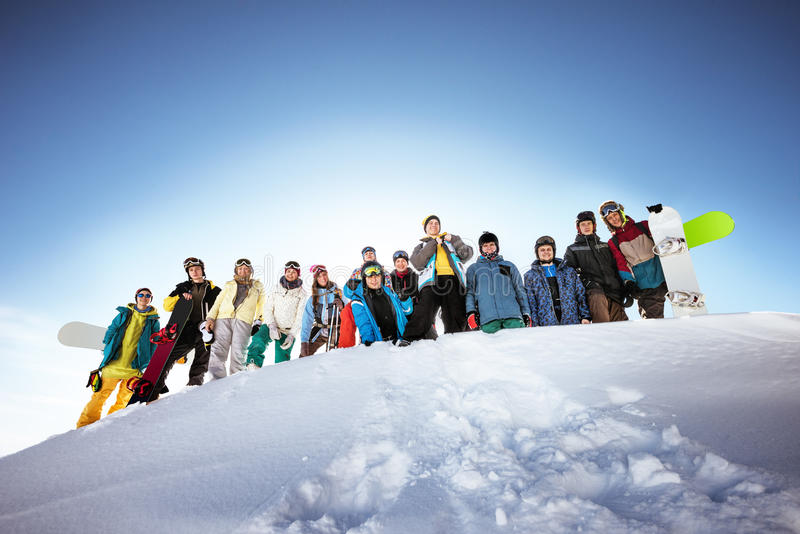 Group of skiers and snowboarders stock images
