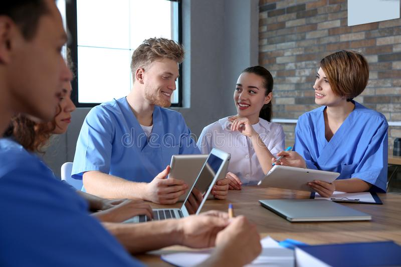 Group of smart medical students with gadgets. In college royalty free stock photography