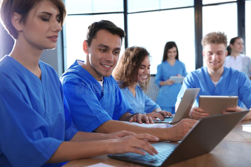 Group of smart medical students with gadgets. In college stock photography