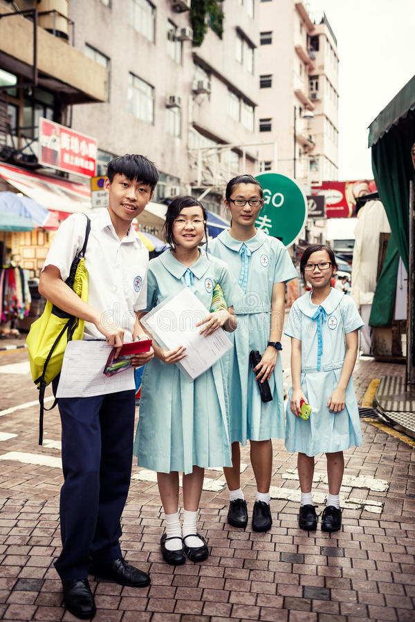 Group of smiling asian students stock images