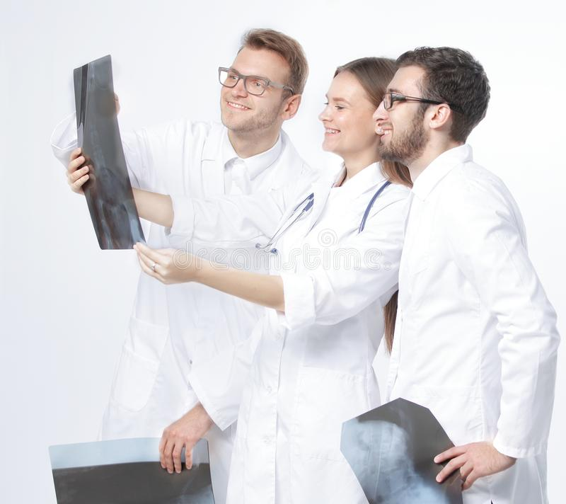 Group of smiling doctors discussing x-rays .isolated on white stock photography